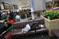 A girl sleeping in Taoyuan Airport,